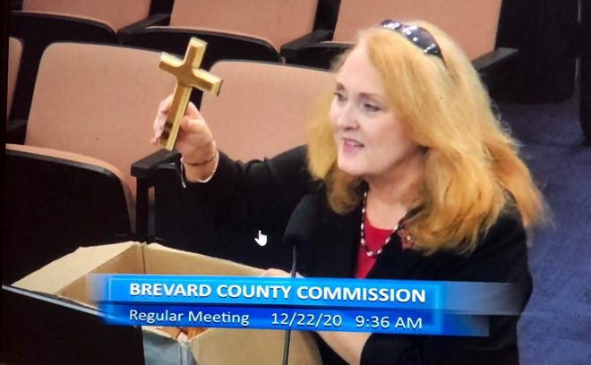 Evie Ostrander, a member of the ministerial staff at the Mission Church in Palm Bay, spoke in favor of the County Commission's proposed invocation policy on Tuesday and brought handmade wooden crosses to the meeting for the commissioners.