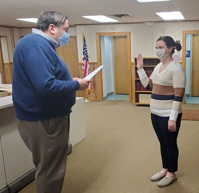Galion Law Director Thomas Palmer swears in Kara Ault as a city council representative on Wednesday.