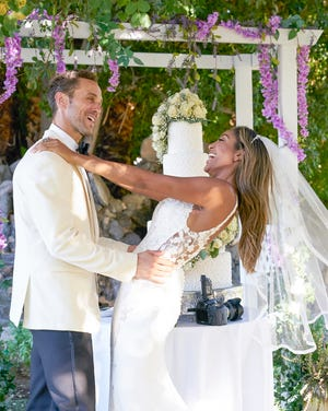 Tayshia and Zac C. dress up to capture some lovely wedding photos on 'The Bachelorette.' He reveals himself to be a real survivor, surprising the Bachelorette and compelling her to see him in a different light. (ABC/Craig Sjodin)