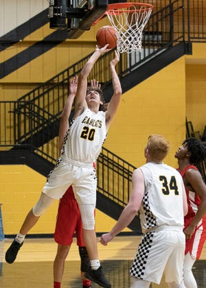 Paint Valley's Dax Estep takes it to the rim to score against Hillsboro during a game Tuesday night at Paint Valley High School. Paint Valley fell to Hillsboro 66-53.