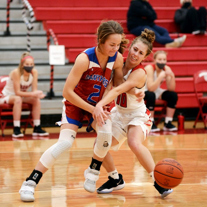 Sheridan's Bailey Beckstedt and Alicia Graham, left, go after a loose ball during the Generals' 73-58 win against visiting Licking Valley on Tuesday at Glen Hursey Gymnasium.