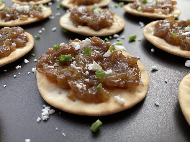 Water Crackers with Onion Pear Spread and Crumbled Goat Cheese