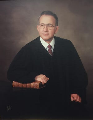 Carl D. Melton was Henderson County's first circuit judge for the 51st Judicial District, which began operations at the beginning of 1971. He had been appointed to the position Dec. 30, 1970, and served in that capacity through 1991. Before becoming judge he was elected  state representative in 1953 and 1956, served 12 years as Henderson County attorney beginning in 1957, and was elected commonwealth attorney in 1969. This photo is a copy of one taken by Joe Martin that hangs in the Henderson County Judicial Center.