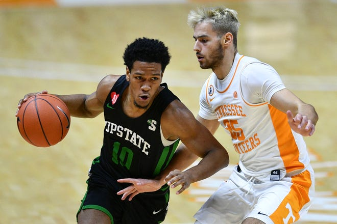 USC Upstate's Tommy Bruner (10) is guarded Tennessee's Santiago Vescovi (25) during an NCAA men's basketball game in Knoxville, Tenn. on Wednesday, December 23, 2020.