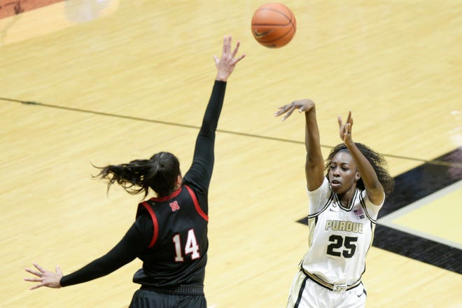 Purdue forward Tamara Farquhar (25) goes up for a shot against Nebraska forward Bella Cravens (14) during the fourth quarter of an NCAA women's basketball game, Wednesday, Dec. 23, 2020 at Mackey Arena in West Lafayette.