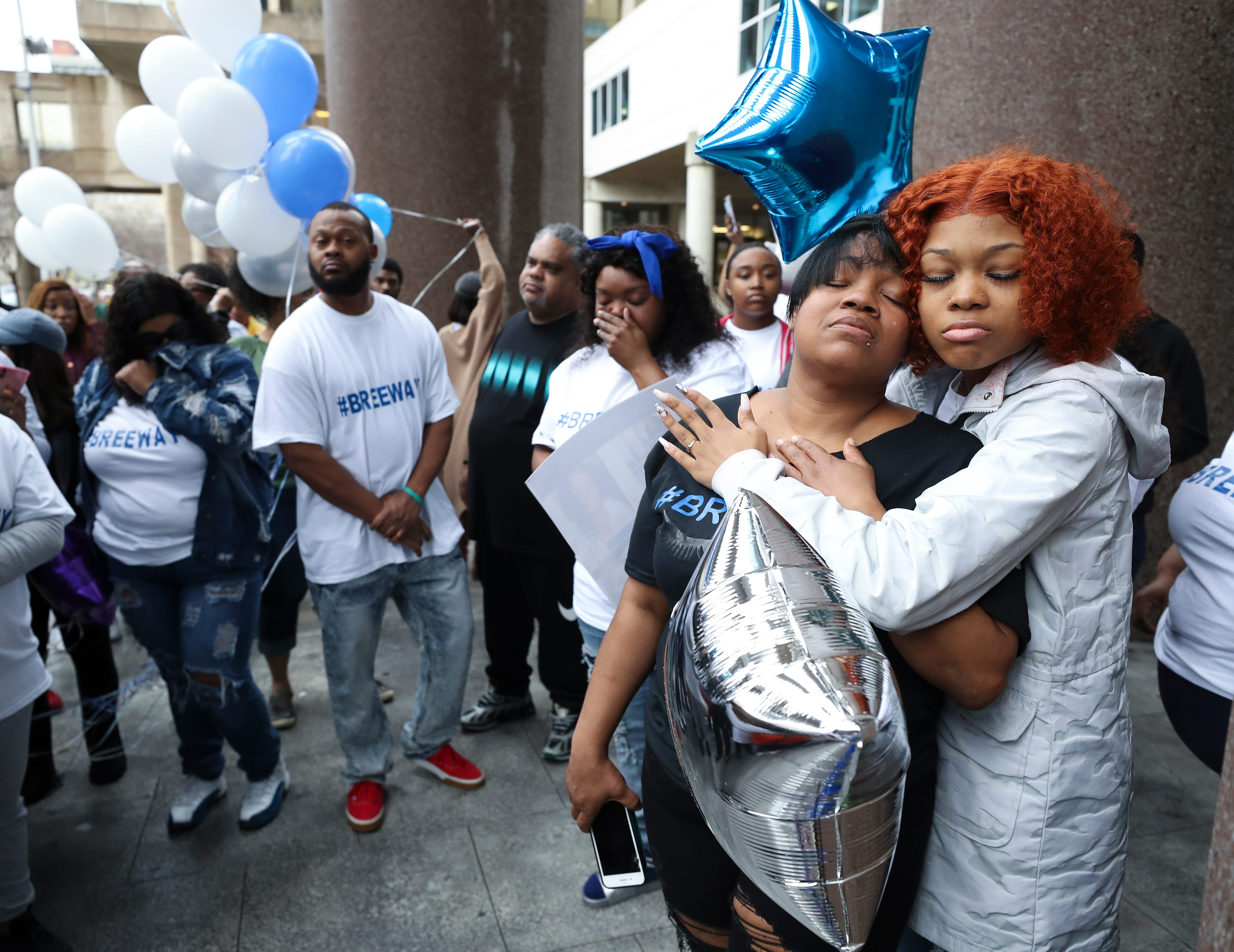 Tamika Palmer, left, embraced her daughter Juniyah Palmer during a vigil for her other daughter, Breonna Taylor, outside the Judicial Center in downtown Louisville, Ky. on Mar. 19, 2020.  Taylor was killed during an officer-involved shooting last week.  The family chose the vigil site because it is across the street from the Louisville Metro Police Department.