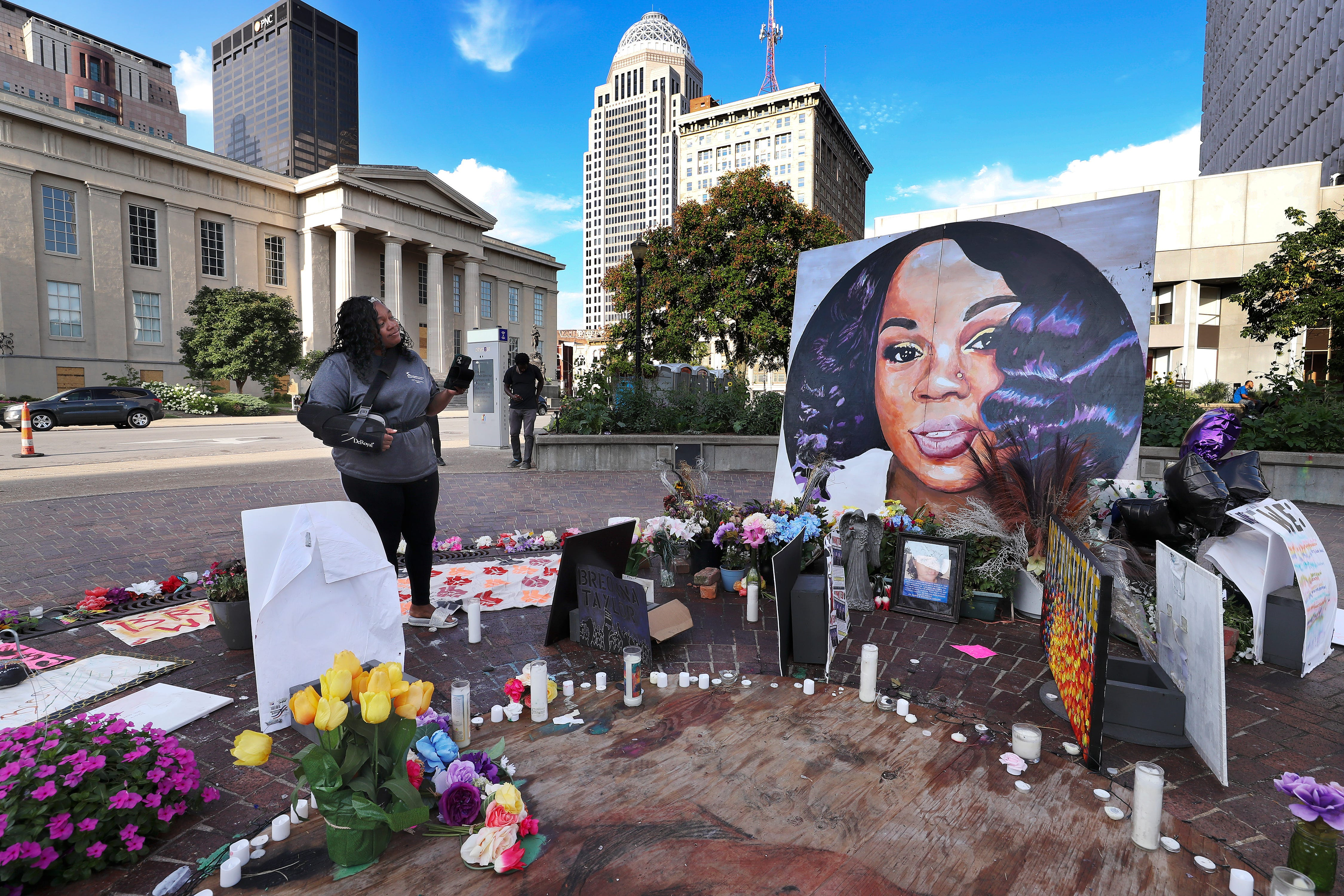 """Tamika Palmer admired a large painting of her slain daughter, Breonna Taylor, that is displayed inside """"Breonna's Circle"""" at Jefferson Square Park on Aug. 5 2020.  She died at the hands of LMPD as they issued a no-knock warrant at her apartment."""