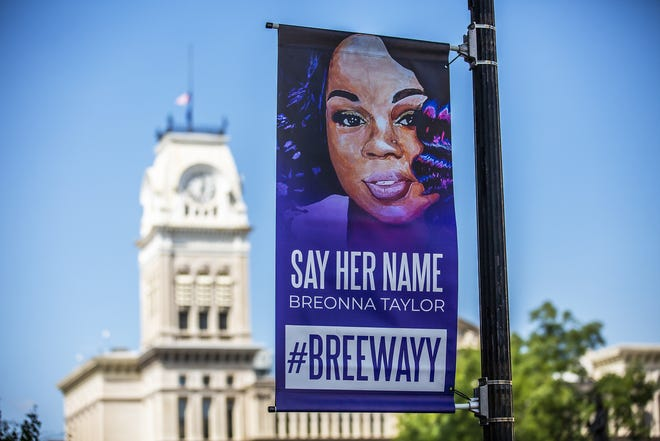 Banners honoring Breonna Taylor were installed along W. Jefferson St. between 5th and 6th Streets in downtown Louisville. Monday, Sept. 14, 2020