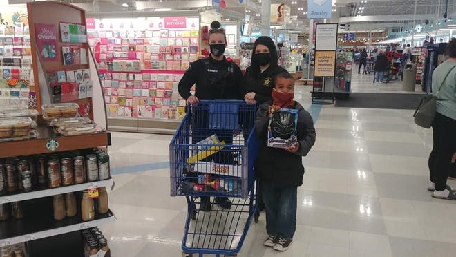 Members of the Steve Young Memorial Lodge of the Fraternal Order of Police participated in the annual Cops and Kids event at Meijer on Dec. 5.