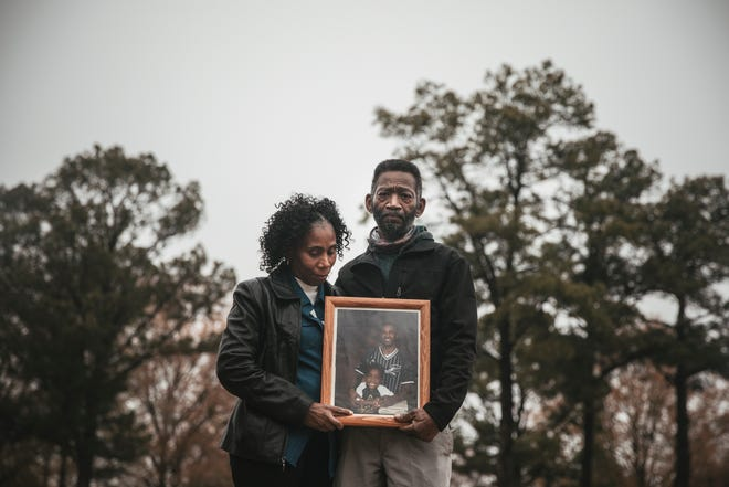 "Leanell ""Troy"" and Jeanette McClenton stand for a portrait near their home in West Memphis, Arkansas. Their son Duntate Young was working at the FedEx hub in Memphis when he was struck by a shipping container door. FedEx was fined $7,000 in connection with Young's death. Andrea Morales for MLK50"