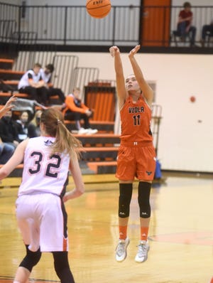Viola's Sami McCandlis launches a 3-pointer during a recent game at Calico Rock.