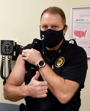 Newark Fire Chief Patrick Connor gives a thumbs up after getting his first dose of Moderna's COVID-19 vaccine on Dec. 23, when the health department began administering the vaccines.