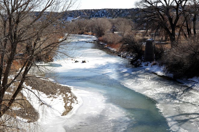 The Animas River flows through Cedar Hill, Wednesday, Dec. 23, 2020, near the place the county plans to build a new boat launch.