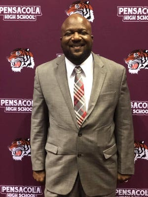 "Cedric Smith was announced as Pensacola High football's head coach on Friday and said it felt like a ""Christmas gift."" Smith has been coaching football since 2002 and spent the last four years at Fort Walton Beach High."