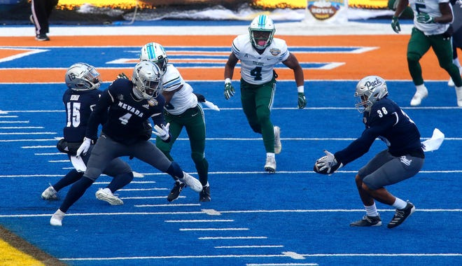 Nevada defensive back Christian Swint (38) picks off a tipped pass during the first half of the Famous Idaho Potato Bowl on Tuesday.