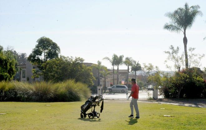 Golfers play at Sterling Hills Golf Club near Beardsley Road and Calle de Debesa in Camarillo on Tuesday, Dec. 22, 2020. John Zaruka, owner of Sterling Hills Golf Club, recently applied for a General Plan amendment to build homes on a portion of the course.