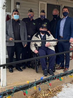 Santa Claus came early for the Vance family on a much needed ramp. From left, Chaplain David Sapata, Cmdr. Jimenez, Robert French, Contractor Scott Davis, Anthony Patterson of Patterson's Family of Dealerships and seated , US Navy veteran John Vance.