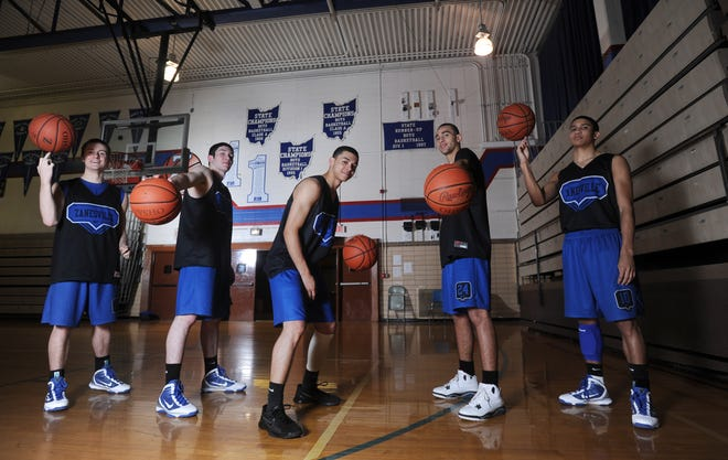 Jordan Bouterse, left, Cole Carpenter, Raheem Forman, Allen Harris and Tanner Gibson, Zanesville High School's starting five, aimed to bring home a state basketball title in 2009-10.