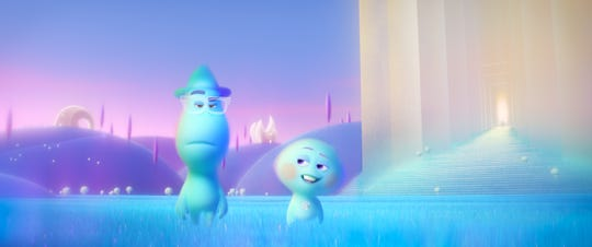"""Joe Gardner (left, voiced by Jamie Foxx) and 22 (voiced by Tina Fey) go on an existential journey about the joys of living in """"Soul."""""""