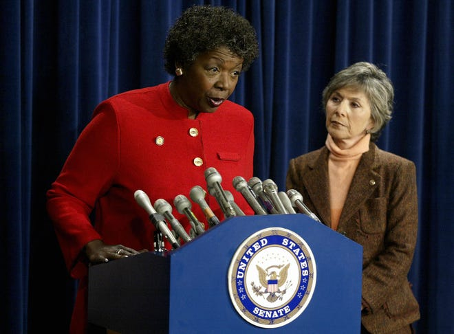 Sen. Barbara Boxer, D-Calif., right, joins Rep. Stephanie Tubbs Jones, D-Ohio, to protest the official electoral vote count in Ohio on Jan. 6, 2005, on Capitol Hill in Washington.
