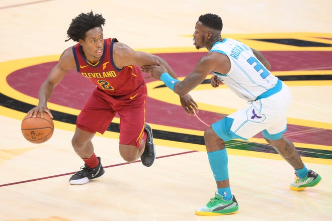 Cavaliers guard Collin Sexton (2) drives against Charlotte Hornets guard Terry Rozier (3) in the fourth quarter at Rocket Mortgage FieldHouse on Wednesday night. Sexton scored 27 points in the Cavs' 121-114 victory. [USA TODAY Sports]
