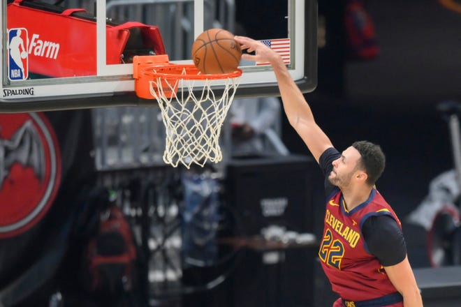 Cavaliers forward Larry Nance Jr. (22) dunks in front of empty seats at Rocket Mortgage FieldHouse. The Cavs have received a variance that will allow up to 2,000 fans at future home games. [David Richard/USA TODAY Sports]
