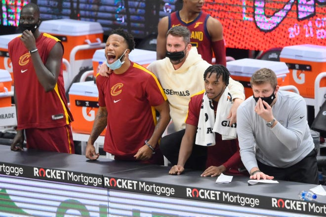 Cavaliers forward Kevin Love, center, is back practicing but coach J.B. Bickerstaff said he will not rush Love back into the lineup, despite the team's needs at power forward. [Associated Press]
