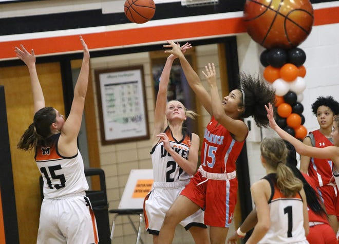 Marlington and Alliance players chasing a rebound during Eastern Buckeye Conference action at Marlington High School on Wednesday, December 23, 2020.