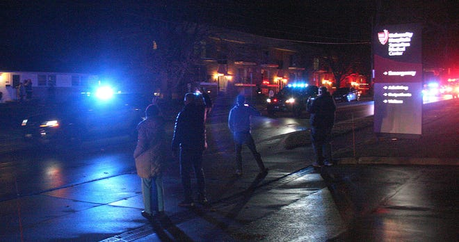 Onlookers wave as Ashland County first responders make their way around UH Samaritan Medical Center Wednesday as part of Operation Spread Christmas Cheer.