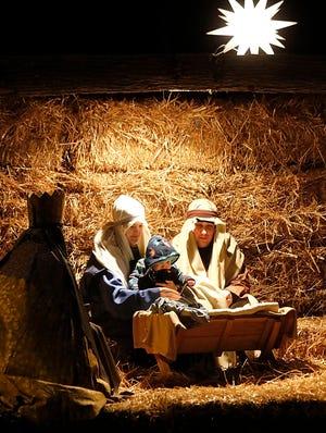 Eli and Rachel Raber and their son, Wyatt, portray the holy family during Savannay's Community Christmas Celebration, a live nativity with the story of Christmas. TOM E. PUSKAR/TIMES-GAZETTE.COM