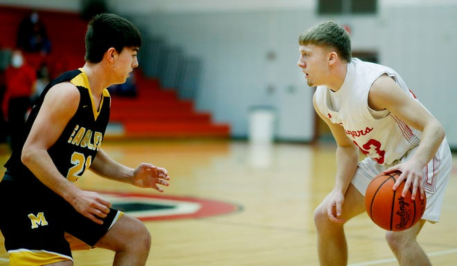 Crestview's Evan Hamilton (23) dribbles as Monroeville's Jimmy Clingman (21) defends during high school boys basketball action on Wednesday. The Cougars won, 66-56.