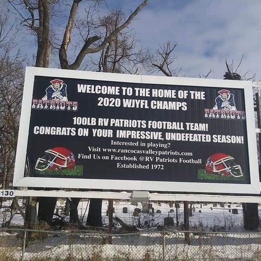 The Township of Mount Holly erected this billboard to honor the Rancocas Valley Patriots' 100-pound team, which completed an undefeated season recently.