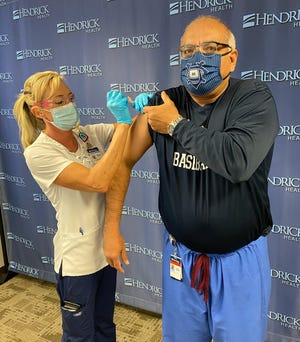 In a photo released Dec. 23, registered nurse Christy Storey administers the first COVID 19 vaccine to Dr. David Morales, MD at Hendrick Medical Center Brownwood.