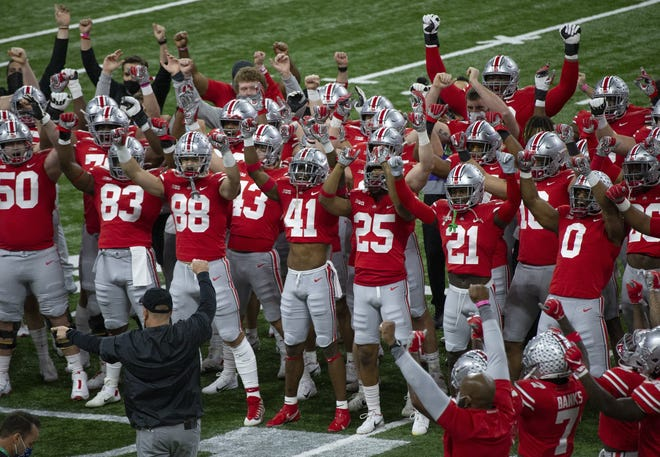 Ohio State players warm up for the Big Ten championship game.