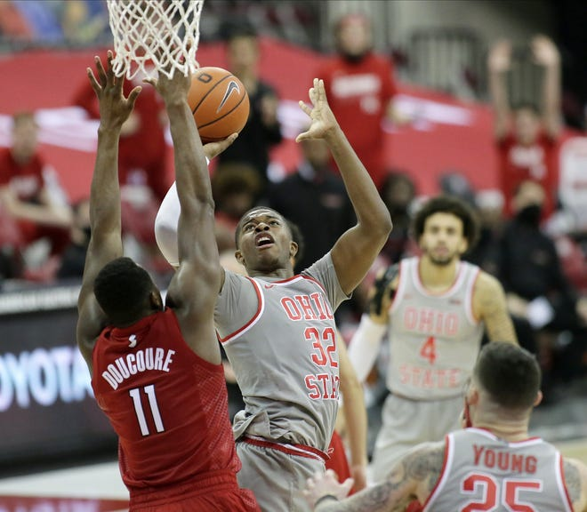 Ohio State Buckeyes forward E.J. Liddell (32) is guarded by Rutgers Scarlet Knights forward Mamadou Doucoure (11) during the second half of Wednesday's NCAA Division I basketball game at Value City Arena in Columbus, Oh. on December 23, 2020. Ohio State won the game 80-68.