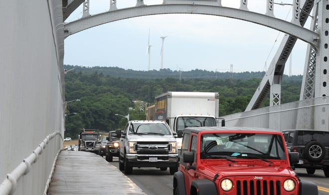 Automatic license plate readers that take photos of license plates and record date and time data of vehicles crossing the Sagamore and Bourne bridges - and other sites across the state - will not be used for the time being because of a data recording glitch.