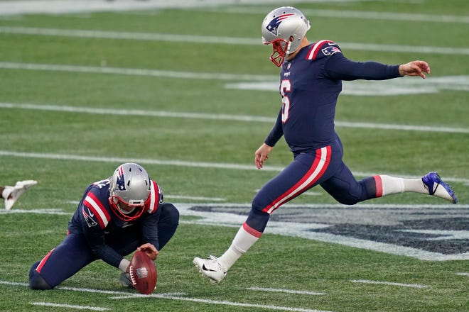 New England Patriots kicker Nick Folk kicks a game-winning field goal against the Arizona Cardinals on Nov. 29 in Foxboro.
