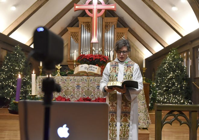 Rev. Libby Gibson Catania of St. Mary's Episcopal Church in Barnstable prepares the online Christmas service for her parishioners. The pandemic has forced local churches to find alternative ways to celebrate the holiday.