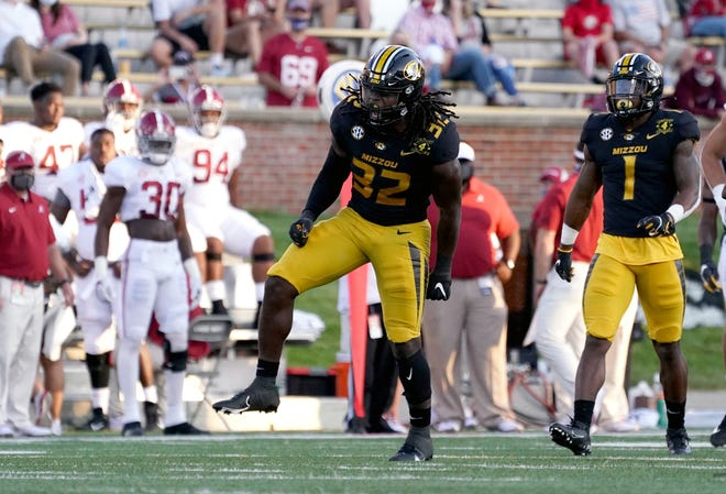 Missouri linebacker Nick Bolton (32) celebrates after making a tackle against Alabama during a game Sept. 26 at Faurot Field.
