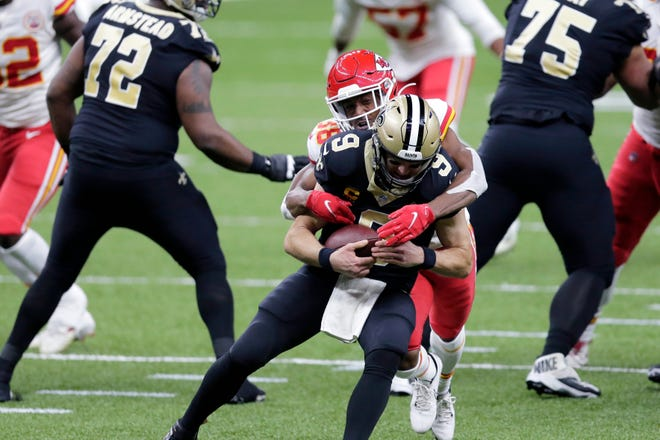 Kansas City Chiefs cornerback L'Jarius Sneed brings down New Orleans Saints quarterback Drew Brees.