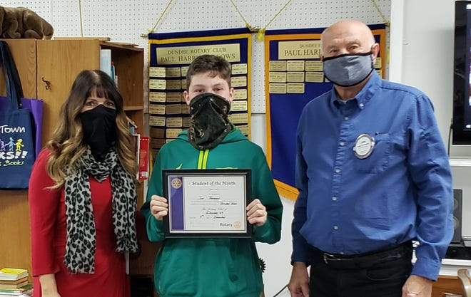 Ian Thompson, October's Student of the Month, is pictured with Dundee Central School Superintendent and Rotary member, Kelly Houck, and Rotary President 2020-2021 John Frederick.