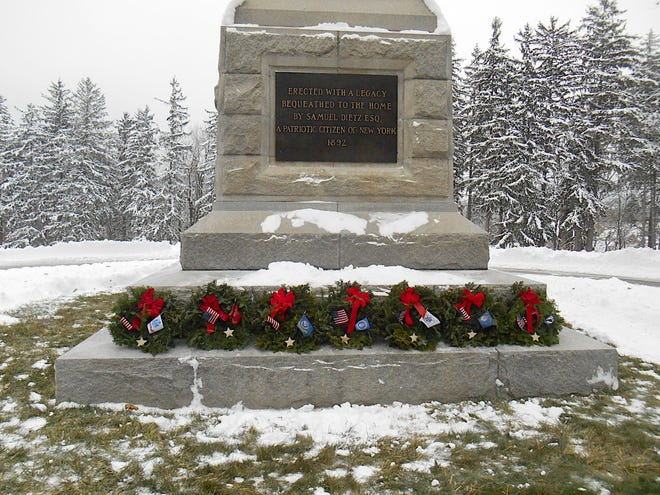 Seven wreaths were placed at the foot of the monument at Bath National Cemetery by veterans representing each branch of the armed forces in honor of the thousands of veterans buried at the cemetery.