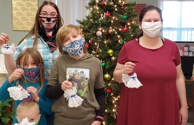 Amanda Ackman, a 4-H volunteer, and her children, Emmit and Kaydence, 4-H members, chose to make beautiful lace angel ornaments to give to each senior at the Council on Aging.