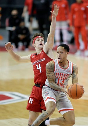 Ohio State guard CJ Walker (13) works against Rutgers guard Paul Mulcahy in the  first half of a win against Rutgers on Dec. 23. Walker is averaging 8.7 points and 4.2 assists per game this season, but only 4.0 points in five Big Ten games.