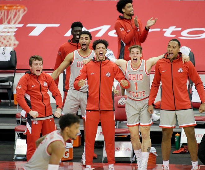 The Ohio State Buckeyes bench reacts after guard Musa Jallow (2) dunked during the second half of Wednesday's NCAA Division I basketball game against the Rutgers Scarlet Knights at Value City Arena in Columbus, Oh. on December 23, 2020. Ohio State won the game 80-68.
