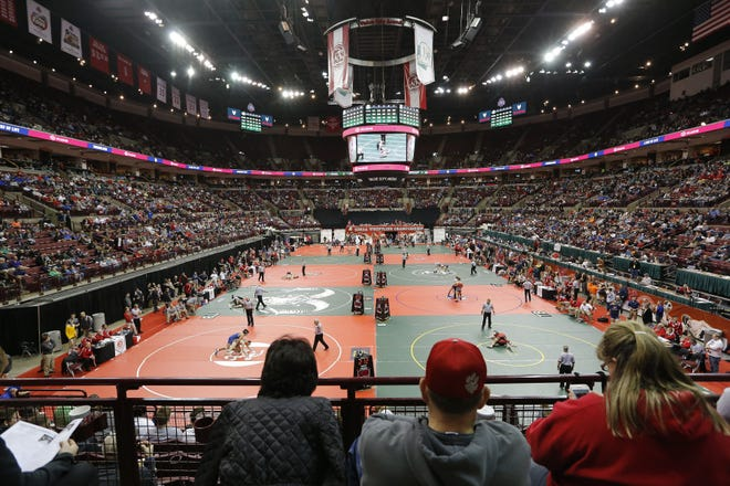 Spectators watch the preliminary round of the state wrestling tournament in March 2019. Wrestling has returned, but it's unclear whether there will be a state tournament at the end of the season.