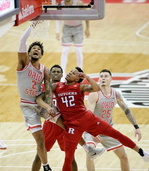 Ohio State Buckeyes guard Musa Jallow (2) is fouled by Rutgers Scarlet Knights guard Jacob Young (42) during the second half of Wednesday's NCAA Division I basketball game at Value City Arena in Columbus, Oh. on December 23, 2020.
