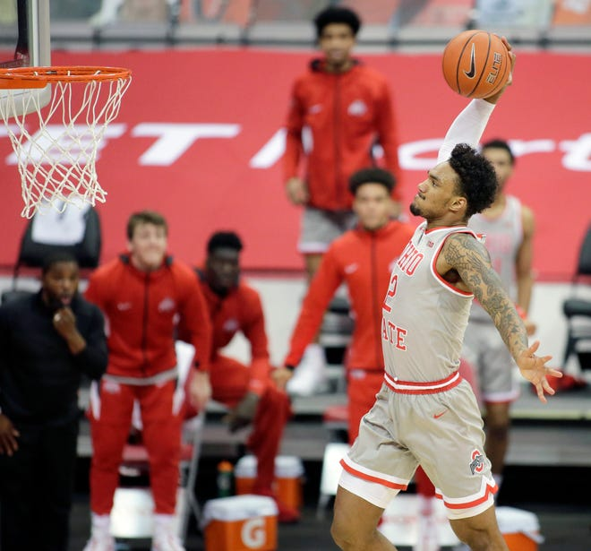 Ohio State Buckeyes guard Musa Jallow (2) flies to the hoop for a dunk during the second half of Wednesday's NCAA Division I basketball game against the Rutgers Scarlet Knights at Value City Arena in Columbus, Oh. on December 23, 2020. Ohio State won the game 80-68.