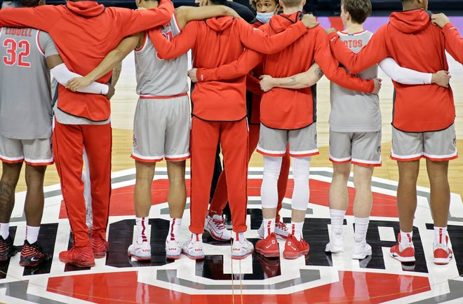 "The Ohio State Buckeyes sing ""Carmen Ohio"" following a 80-68 win over the Rutgers Scarlet Knights during Wednesday's NCAA Division I basketball game at Value City Arena in Columbus, Oh. on December 23, 2020."