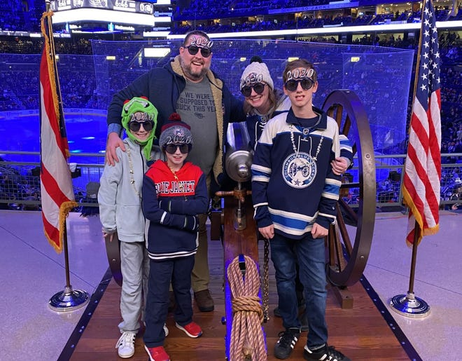 Jason and Kristi Embrey have attended the last two Columbus Blue Jackets games on New Year's Eve with their three boys, from left, Jake, Cole and Max. This year, the family will instead enjoy a quiet night at their Crooksville home.